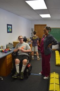 Vision therapy with boy and female staff member