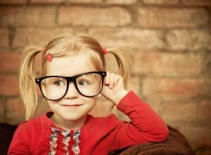 Funny little girl with glasses