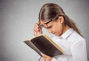 girl studying a book