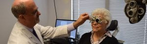Low Vision eye exam with older woman